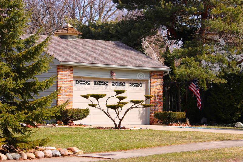 A Garage With Landscaping stock photography