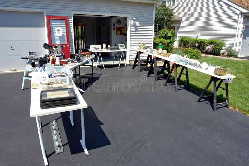 Garage Sale of Jumble Rummage Tables in House Yard stock image