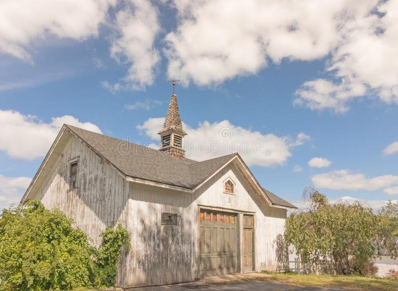 Garage and storage shed with weathervane royalty free stock photos