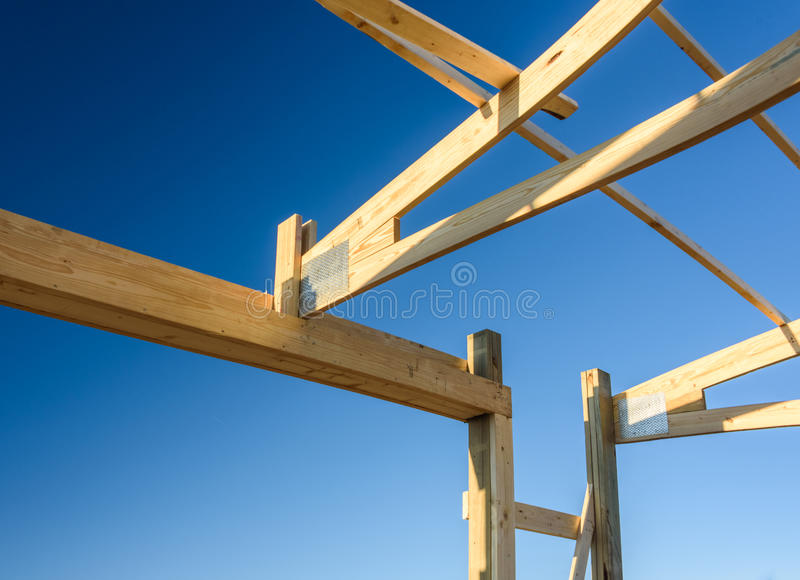 Garage truss pole building. Timber, wooden truss attachment. Construction site framing royalty free stock image