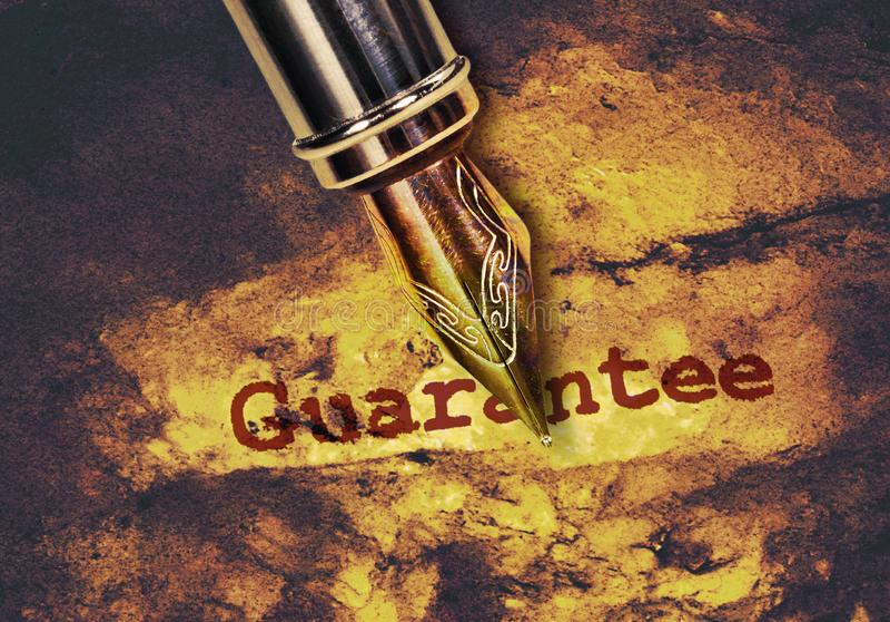 Garantie de Word et un stylo photos libres de droits