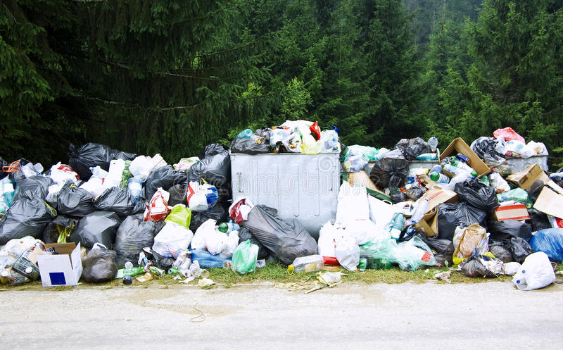 Garbage. Waste, mountain road full of all sort of trash royalty free stock image