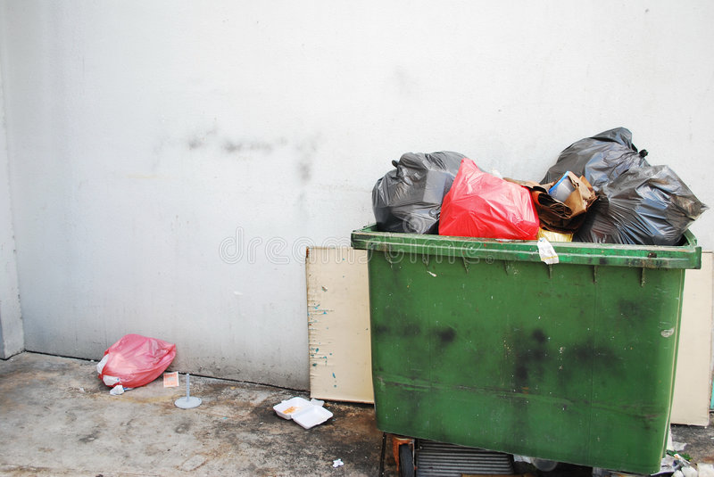 Garbage. Trolley with overflowing rubbish royalty free stock image