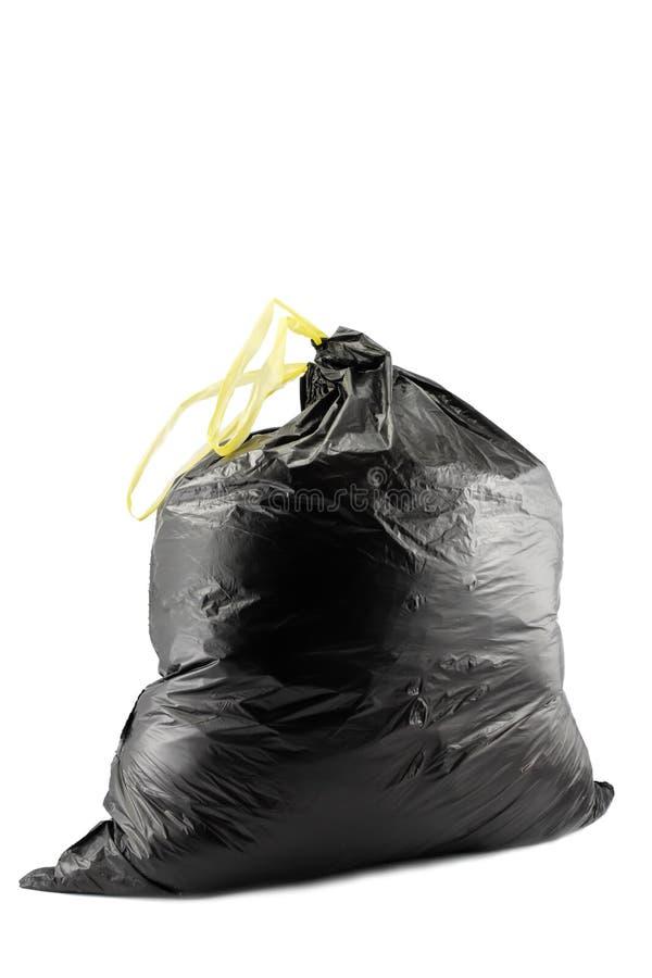 Garbage bag. Black garbage bag isolated on white royalty free stock images