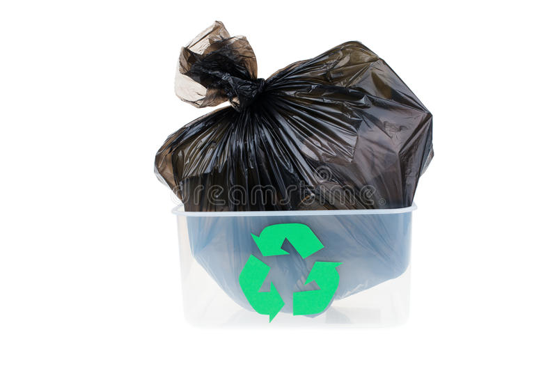 Garbage bag in a plastic bin isolated on white background royalty free stock image