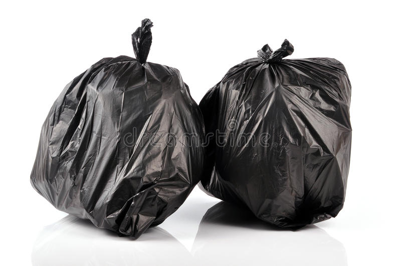 Garbage bags. Black british garbage bags isolated on white background royalty free stock images