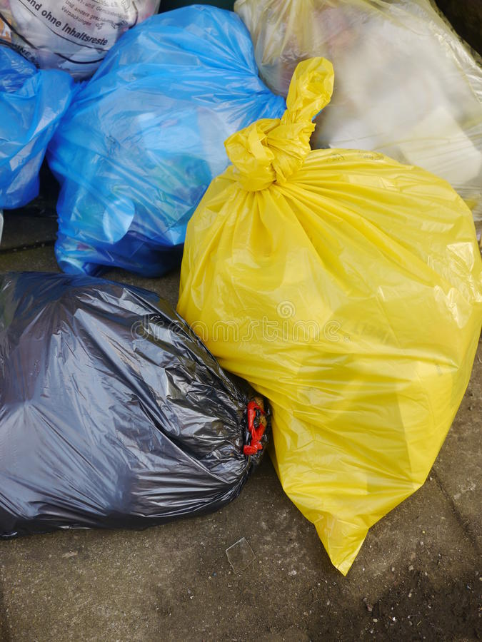 Garbage Bags. Many Garbage Plastic Bags With Different Colours Piled Up royalty free stock images