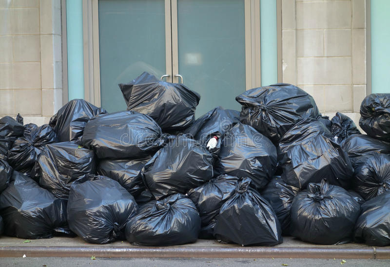 Garbage Bags. A pile of black garbage bags in New York City stock image