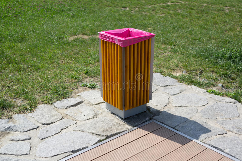 Garbage bin. / basket / container. Green grass in the background stock photography