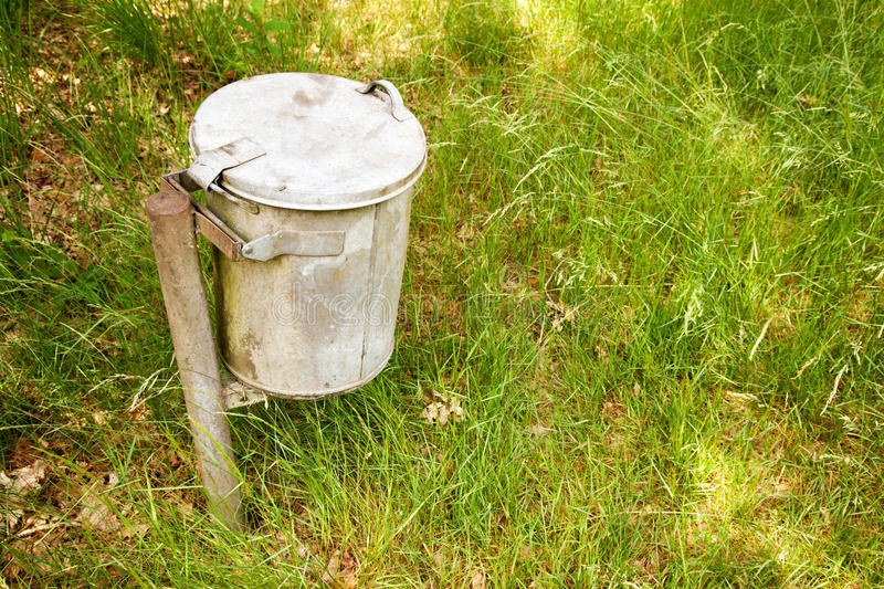 Download Garbage bin in the grass stock image. Image of dustbin - 26161149