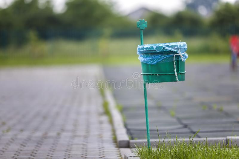 Garbage bin outdoor on blurred sunny background.  royalty free stock photos