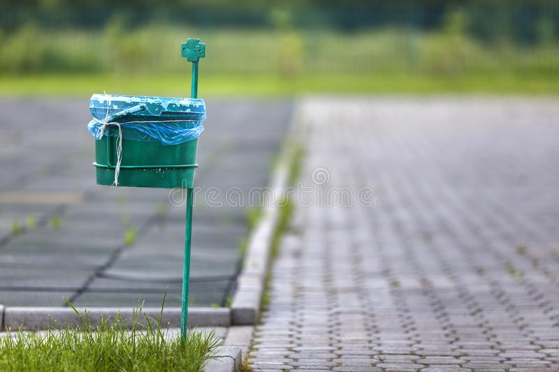 Garbage bin outdoor on blurred sunny background.  stock image