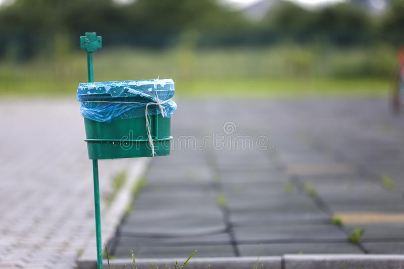 Garbage bin outdoor on blurred sunny background.  stock photos