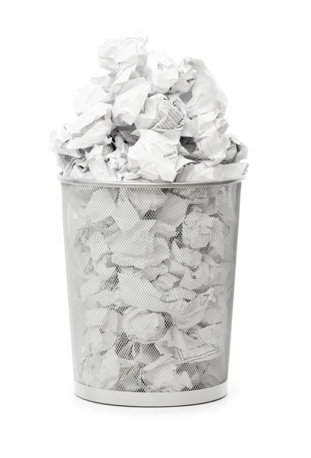 Garbage bin with paper waste isolated. On white stock photo