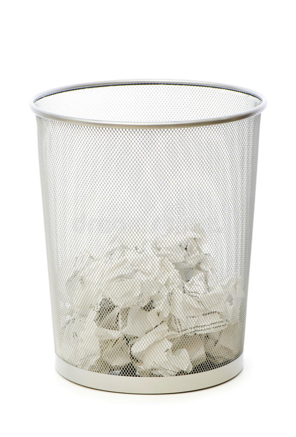 Garbage bin with paper waste isolated. On white stock photos