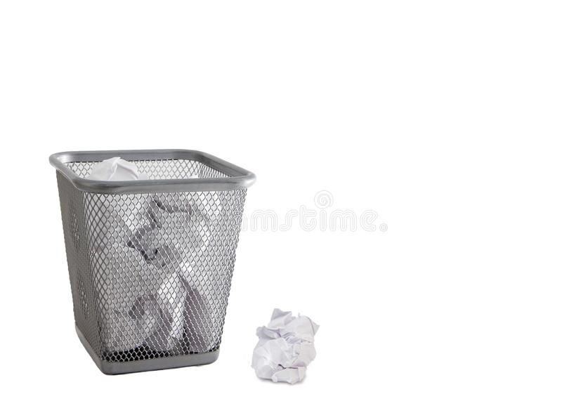 Garbage bin with paper waste isolated on white stock photography