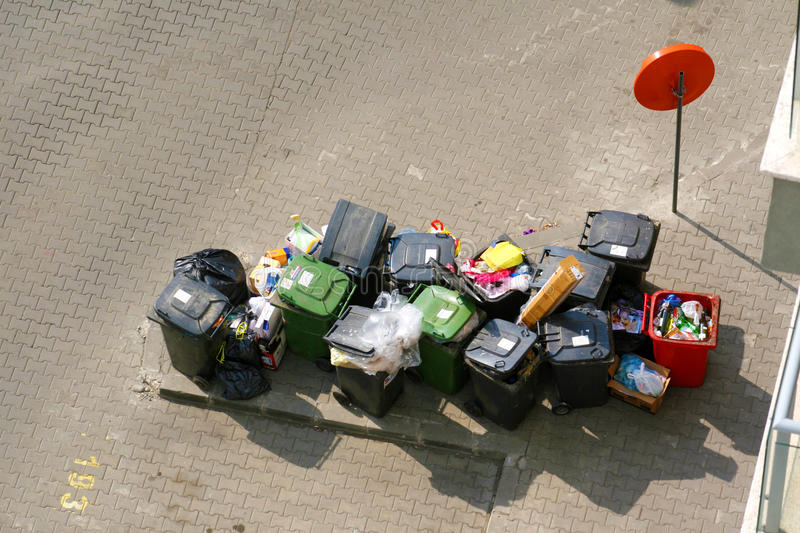 Garbage bins. In the street photographed from above, waiting to be picked by the garbage truck royalty free stock photo