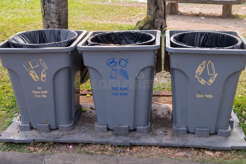 Garbage bins for each category placed at various points in the park. S royalty free stock photos