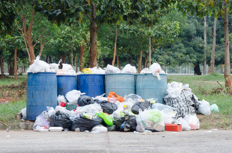 Garbage bins. Overflowing garbage bins that cause pollution stock photos