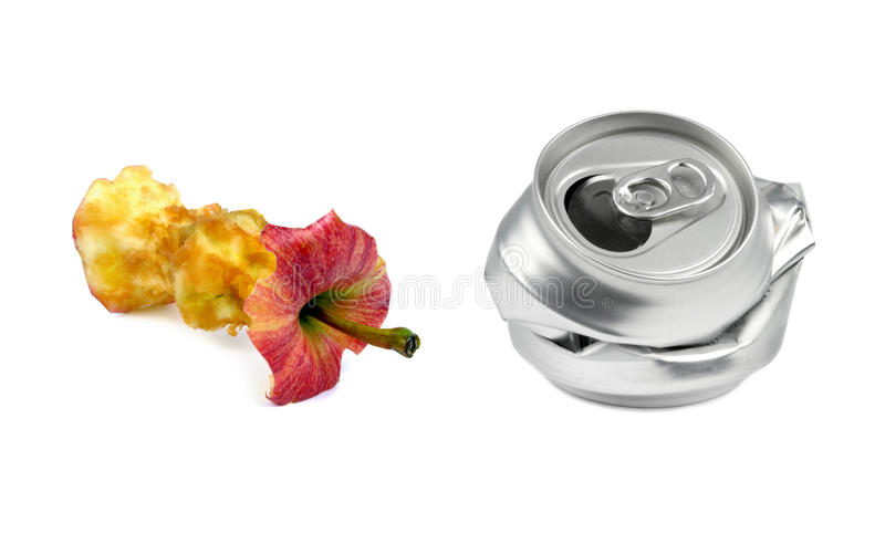 Garbage. Bitten apple and crushed drink can stock photography
