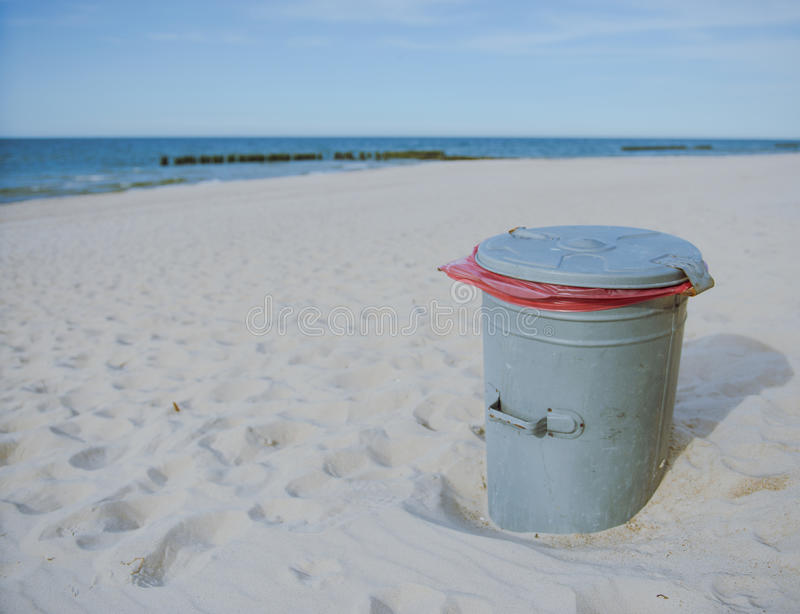 Garbage can at the beach. Over Baltic Sea stock image