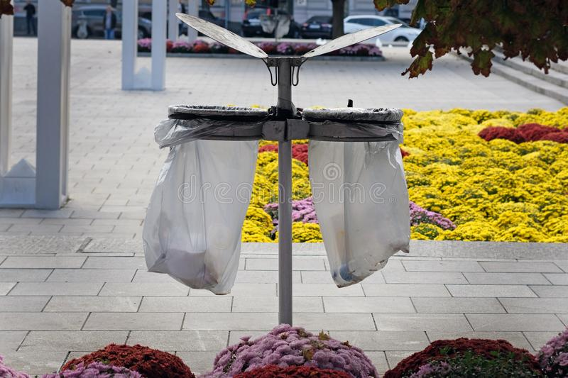 Garbage can with lid and trash bag holders. royalty free stock photos