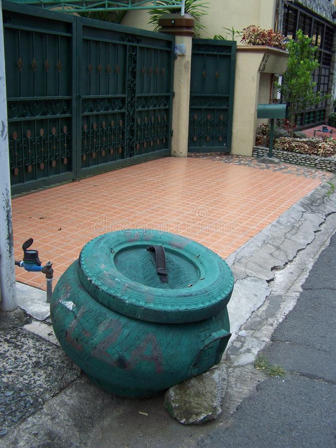 Garbage can made from rubber tire in the Philippines. Garbage pick-up in the Philippines in the city of Las Pina`s city stock photography