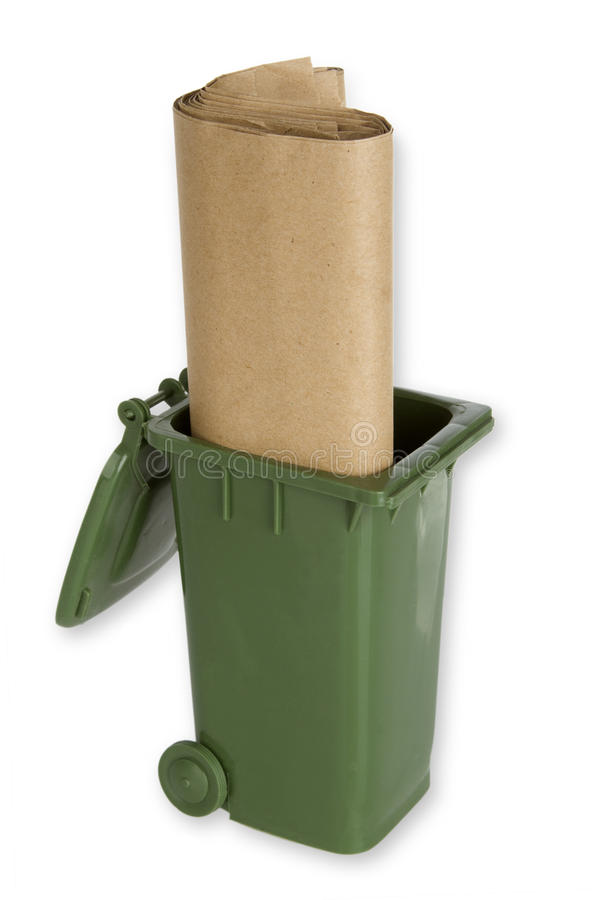 Garbage can with paper trash bags stock photo