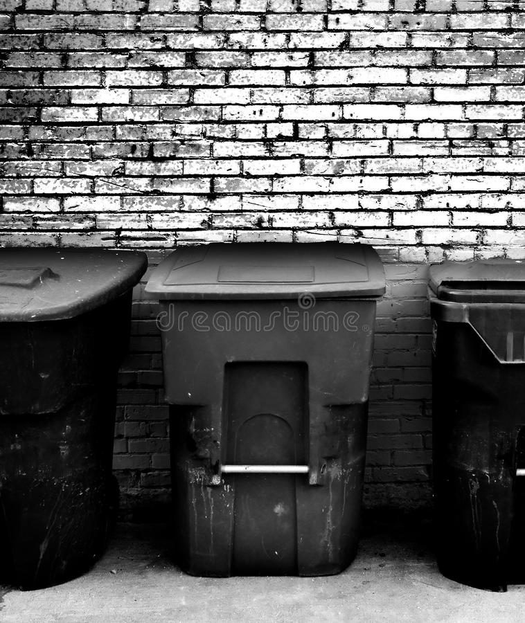 Garbage Cans. Row of Garbage Cans in an Alley royalty free stock photos
