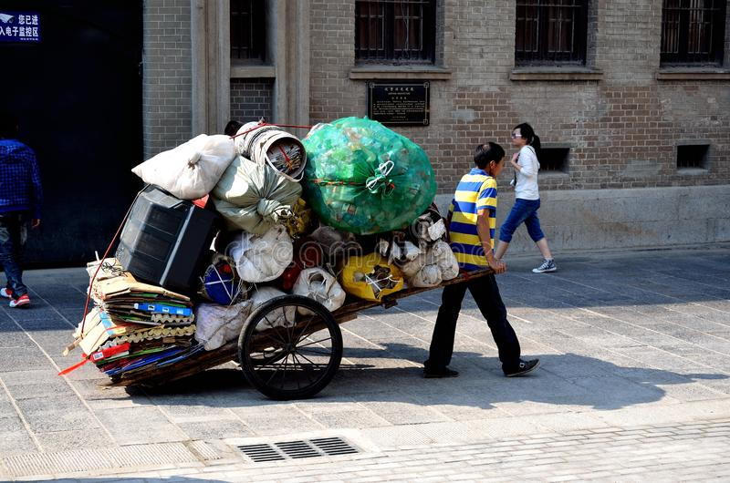 Garbage collector. Walking on the street,wuhan city, hubei province royalty free stock photography