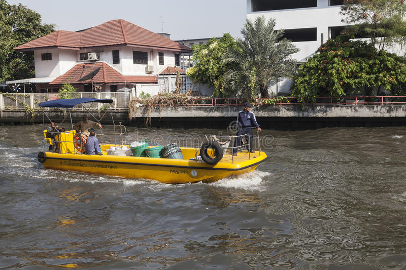 Garbage collectors boat on Khlong channel in Bangkok. Khlong channel is one of the main traffic paths in Bangkok but also important in regulation of the waters stock image