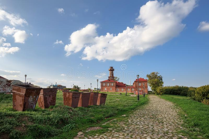 Dumpsters in front of the historical building of the fire house of the 19th century. Sviyazhsk, Republic of Tatarstan, Russia. Garbage containers in front of the royalty free stock images