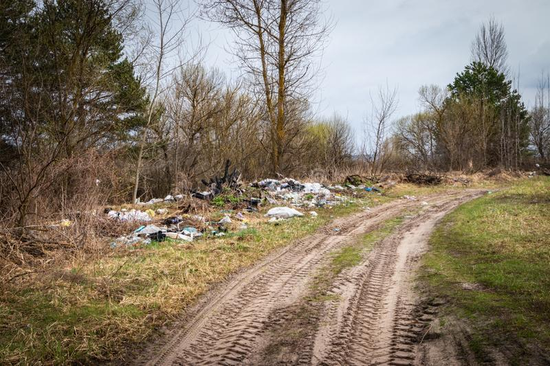 Garbage dump on the side of the road royalty free stock photos