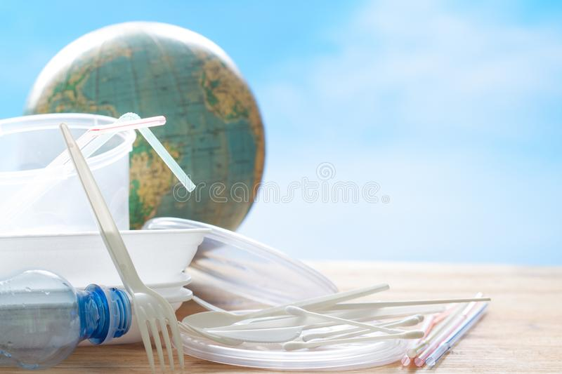Garbage  ecology concept with plastic and globe. Closeup royalty free stock photo