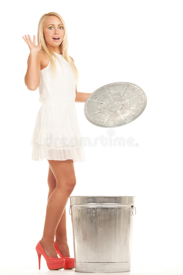 Garbage girl. Shocked young girl near the slop bucket royalty free stock photo