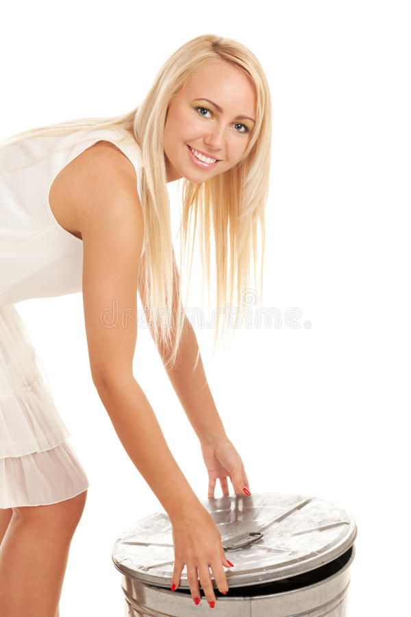Garbage girl. Smiling girl opening on a slop bucket royalty free stock images