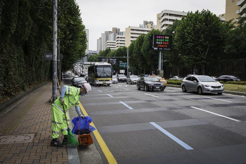 Garbage Man on streets of Seoul stock photo