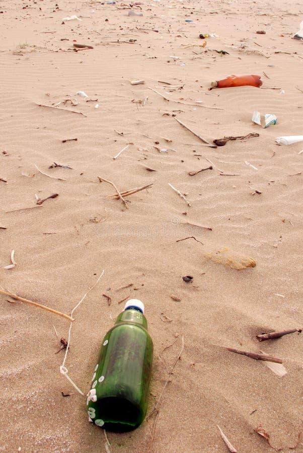Garbage on ocean coast stock image