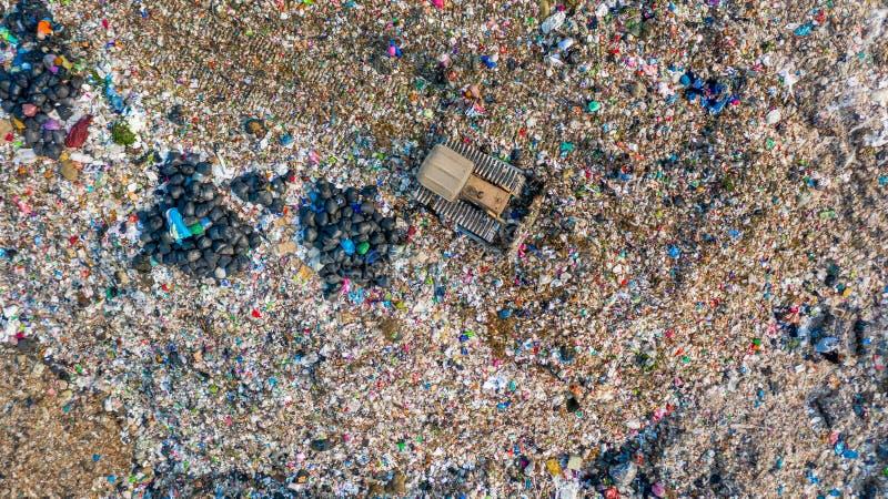 Garbage pile in trash dump or landfill, Aerial view garbage trucks unload garbage to a landfill, global warming stock photo