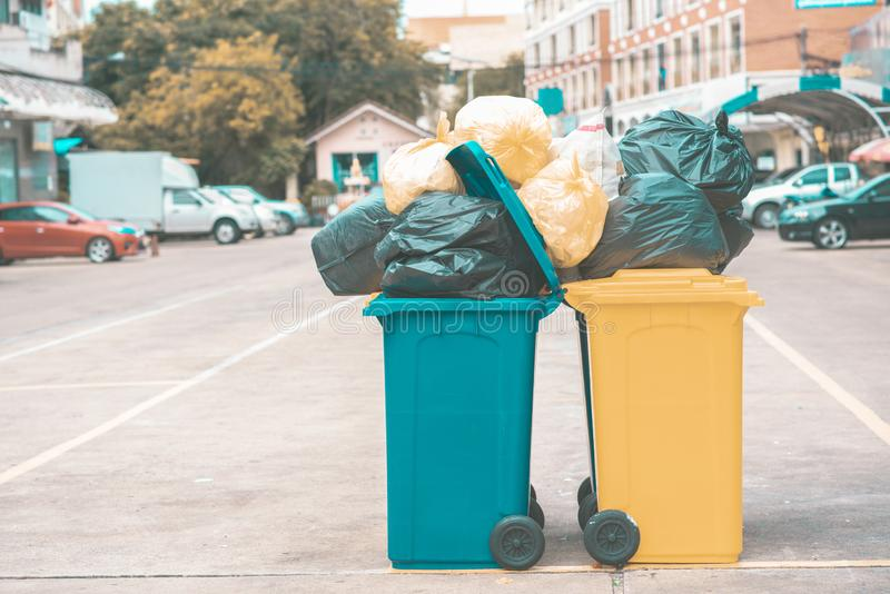 Garbage plastic bags black waste, pollution, lots junk dump, recycle green yellow bin. Many garbage plastic bags black waste, pollution, lots junk dump, recycle stock photography