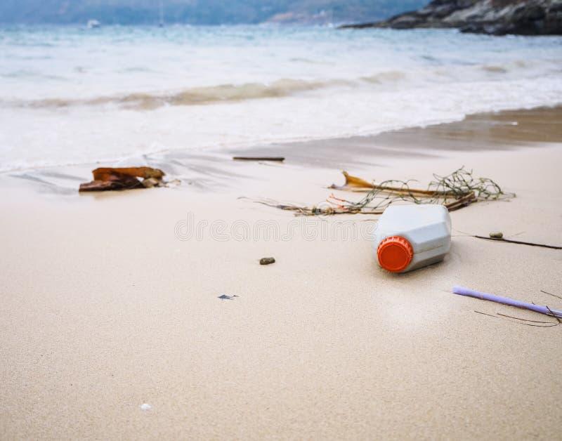 Garbage Rubbish on beach Plastic Bottles Trash Environmental pollution stock photography