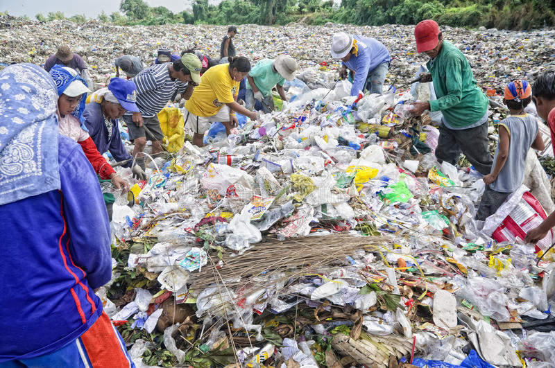 Garbage Scavengers. CAVITE, PHILIPPINESS. - FEBRUARY 12: Unidentified scavengers rummage for recyclable items on February 12, 2010 in Cavite, Philippines stock images