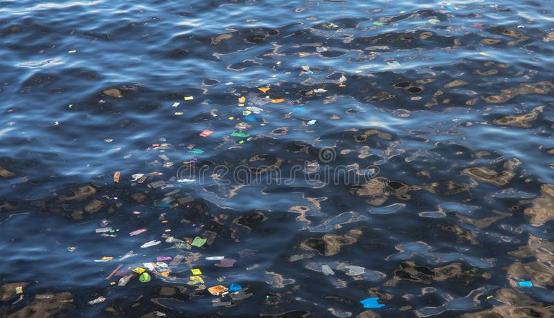 Garbage in sea water. Plastic trash in ocean. Ecological problem. Urban seaside pollution royalty free stock photos