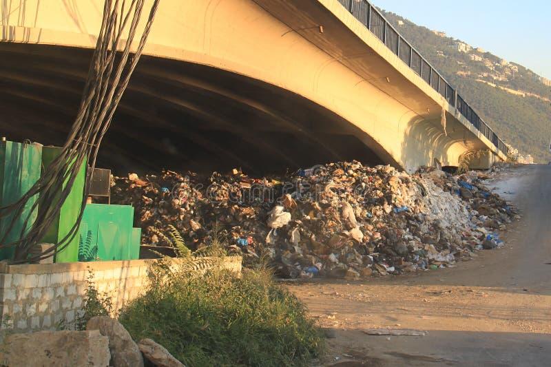 Garbage Thrown Under Bridge, Lebanon royalty free stock images