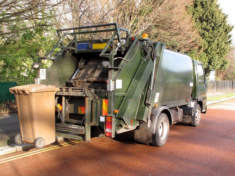 Garbage truck. With elevated wheelie bin stock photos