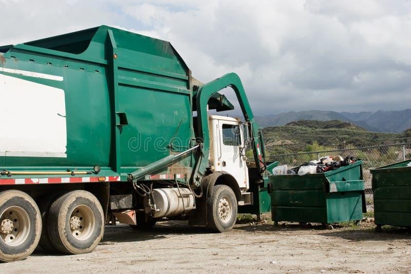 Garbage Truck Making a Pickup stock photos
