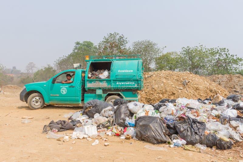Garbage truck of Pai Subdistrict Administrative Organization dumping Garbage at the garbage disposal pond. PAI, THAILAND - April 10, 2016 : Garbage truck of Pai stock images