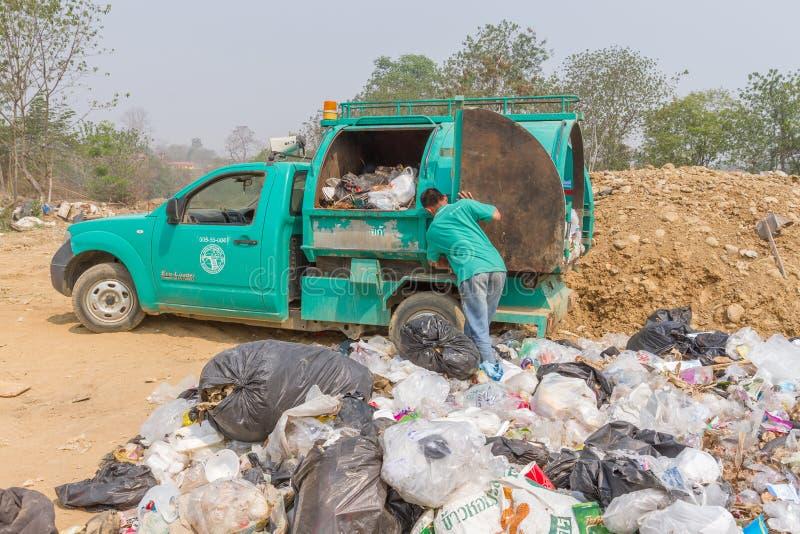 Garbage truck of Pai Subdistrict Administrative Organization dumping Garbage at the garbage disposal pond. PAI, THAILAND - April 10, 2016 : Garbage truck of Pai stock photos