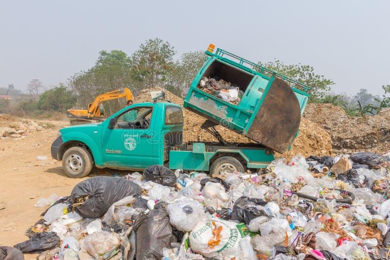 Garbage truck of Pai Subdistrict Administrative Organization dumping Garbage at the garbage disposal pond. PAI, THAILAND - April 10, 2016 : Garbage truck of Pai royalty free stock photo