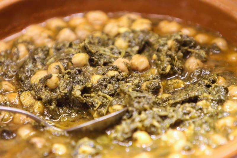 Garbanzos con espinaca. Spanish espinacas con garbanzos, spinach with chickpeas, served as tapas royalty free stock photos